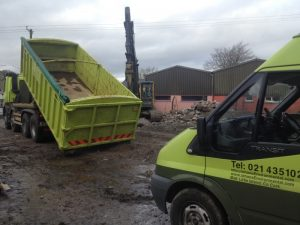 Contaminated Soil Bin being unloaded from Hookloader