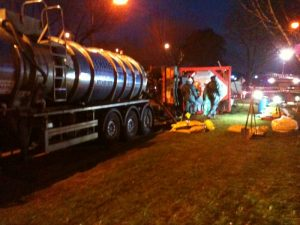 Spill Team carrying out nightime works on overturned ISO tank onboard truck